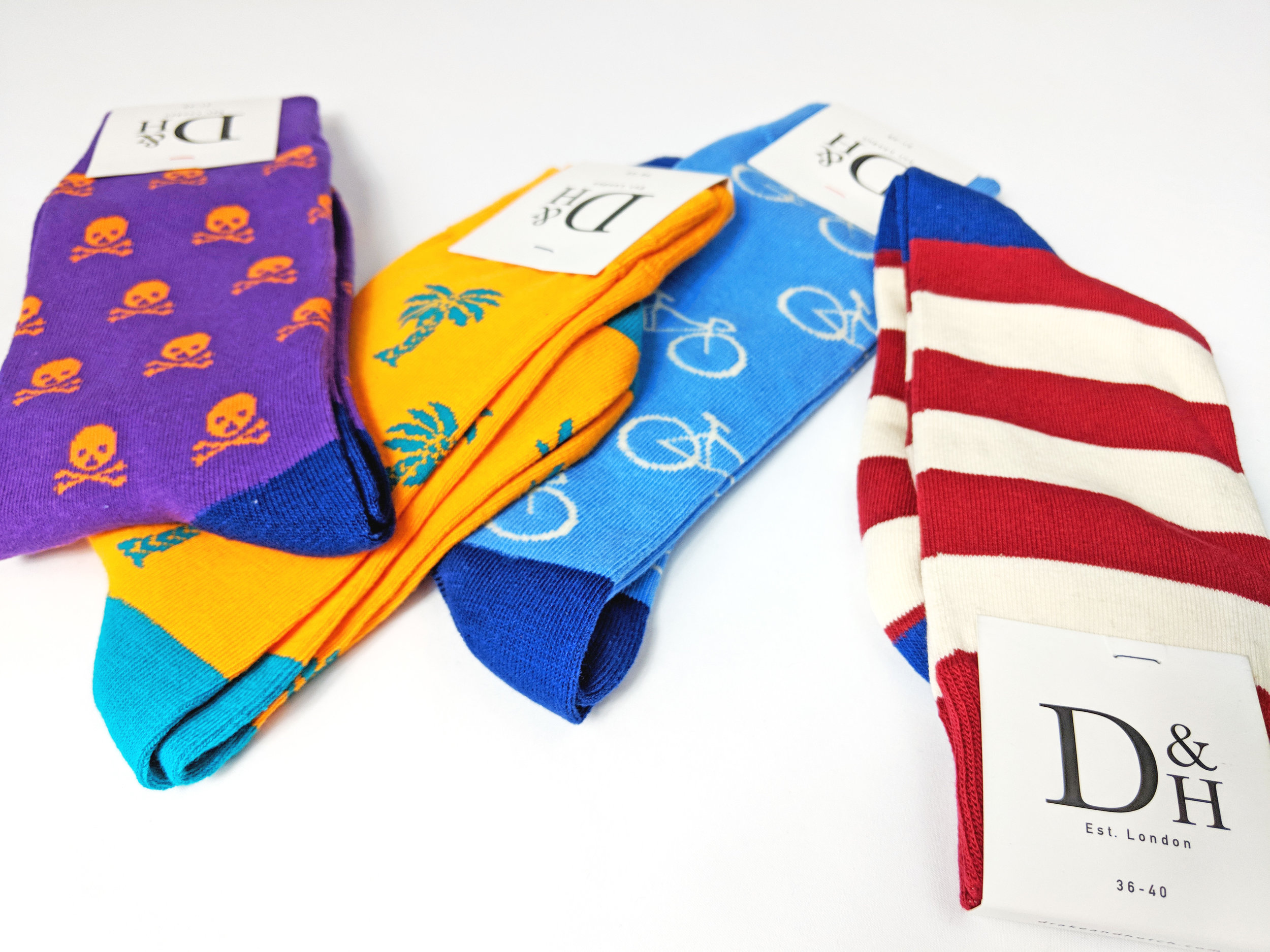 Some of D&H's fun, bright & conversational crew socks. Men's & Women's sizes available. Photo credit: The Sock Review