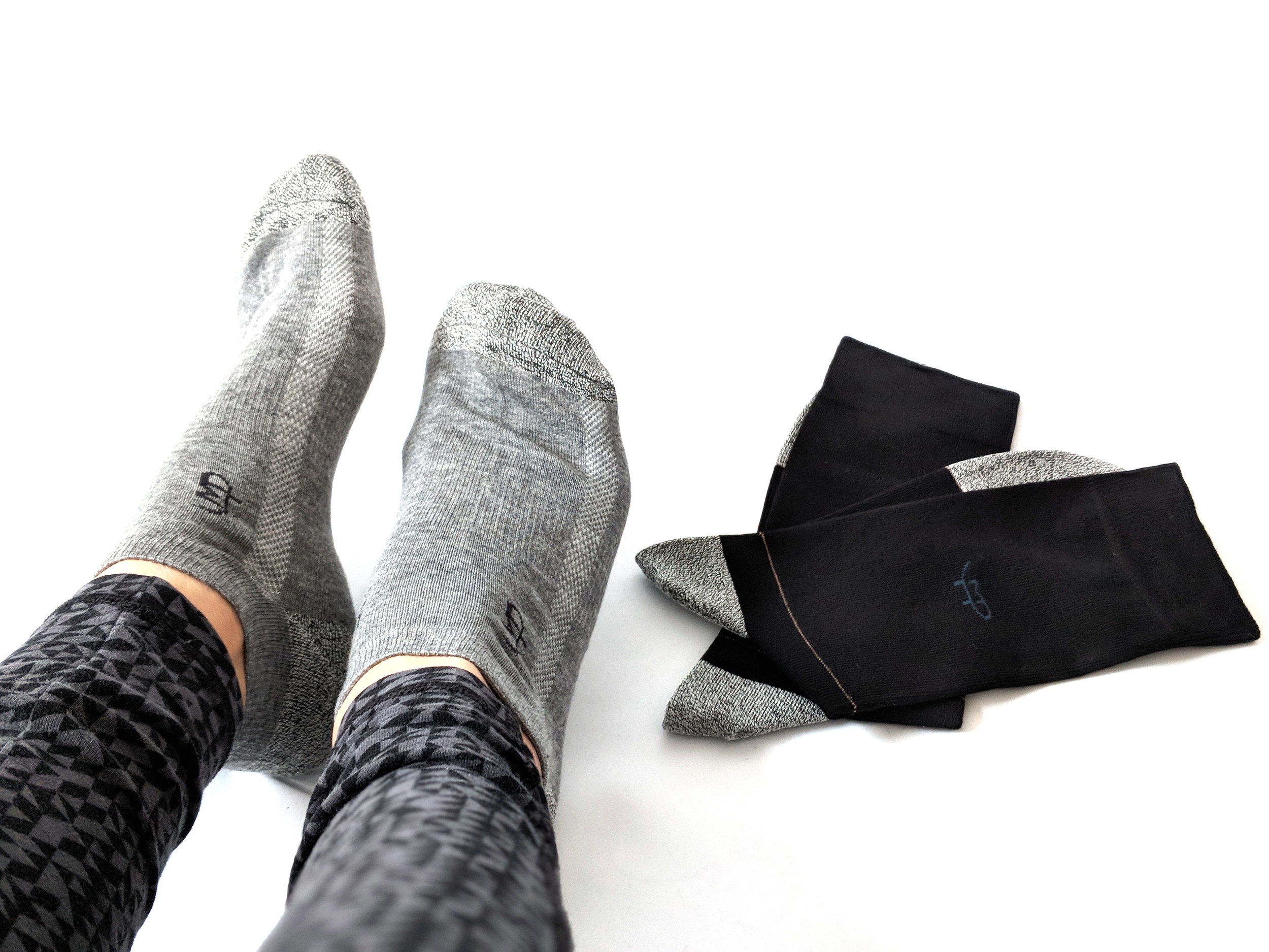 Wearing the grey ankle socks and flat lay of the black crew socks - Photo Credit: The Sock Review