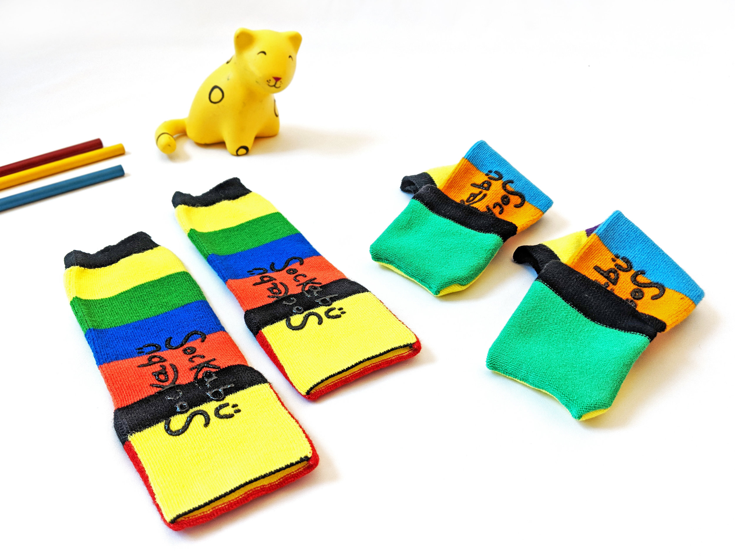 "Sockabu styles offer choices while wearing; the left pair features the ""open-toe"" position, and the pair on the right shows off the ""closed-toe"" view when you flip over the seamless cover. P.S. that little jaguar toy is a prototype of mine from my art school days - Photo Credit: The Sock Review"