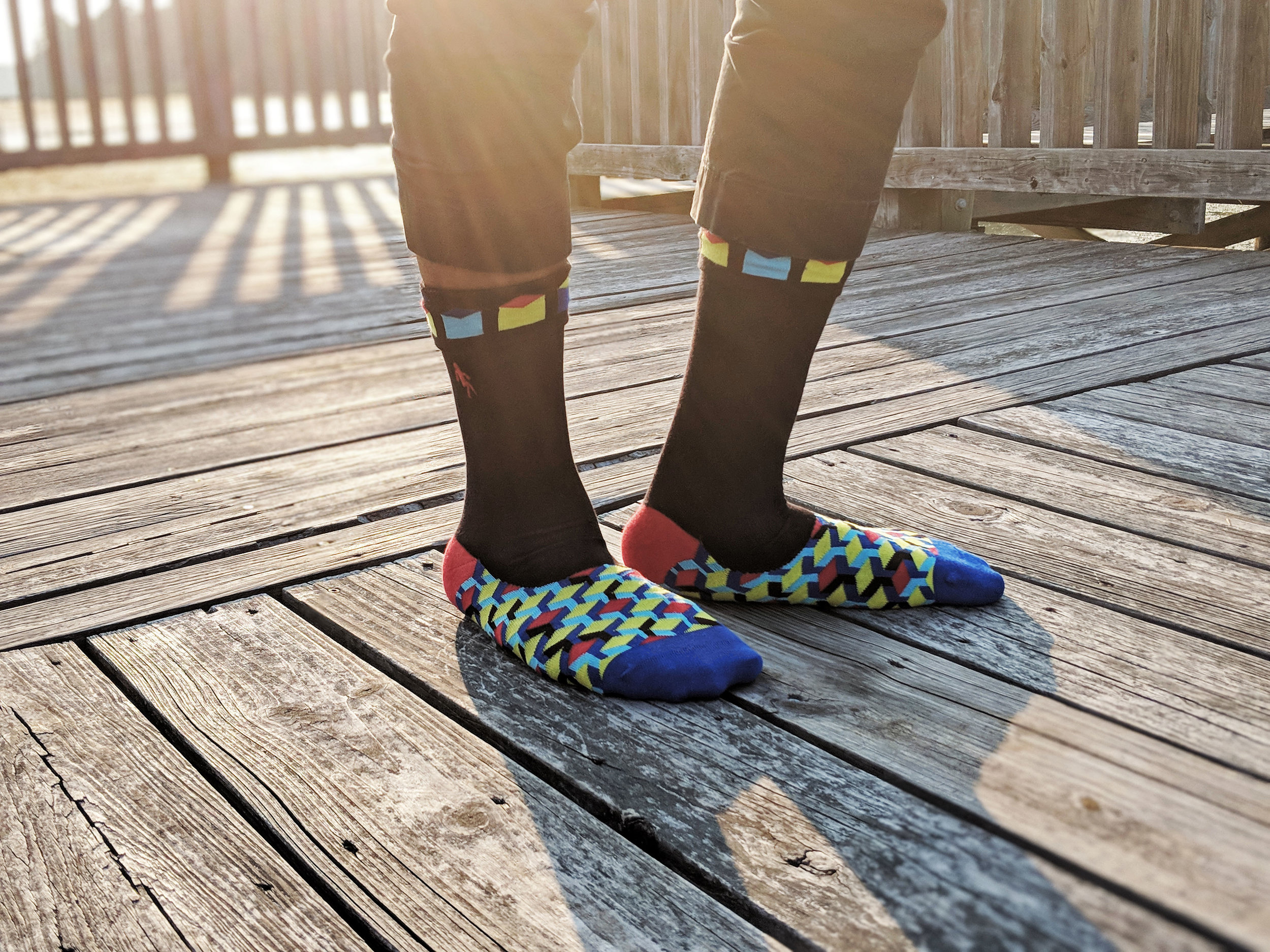 Feeling a little rebellious? Maybe you took a long lunch, and ran out to the park for a little fun in the sun; we did! Our sock model, Nik, shows off Quiet Rebellion's pattern that celebrates Imhotep, the ancient Egyptian architect. Photo Credit: The Sock Review