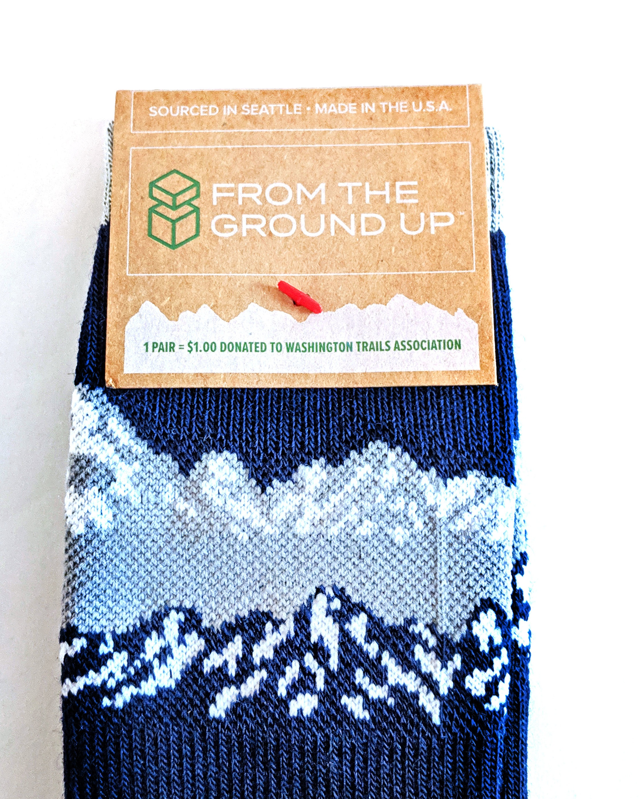 A close-up on packaging; for each pair sold, a donation is made to Washington Trails Association.