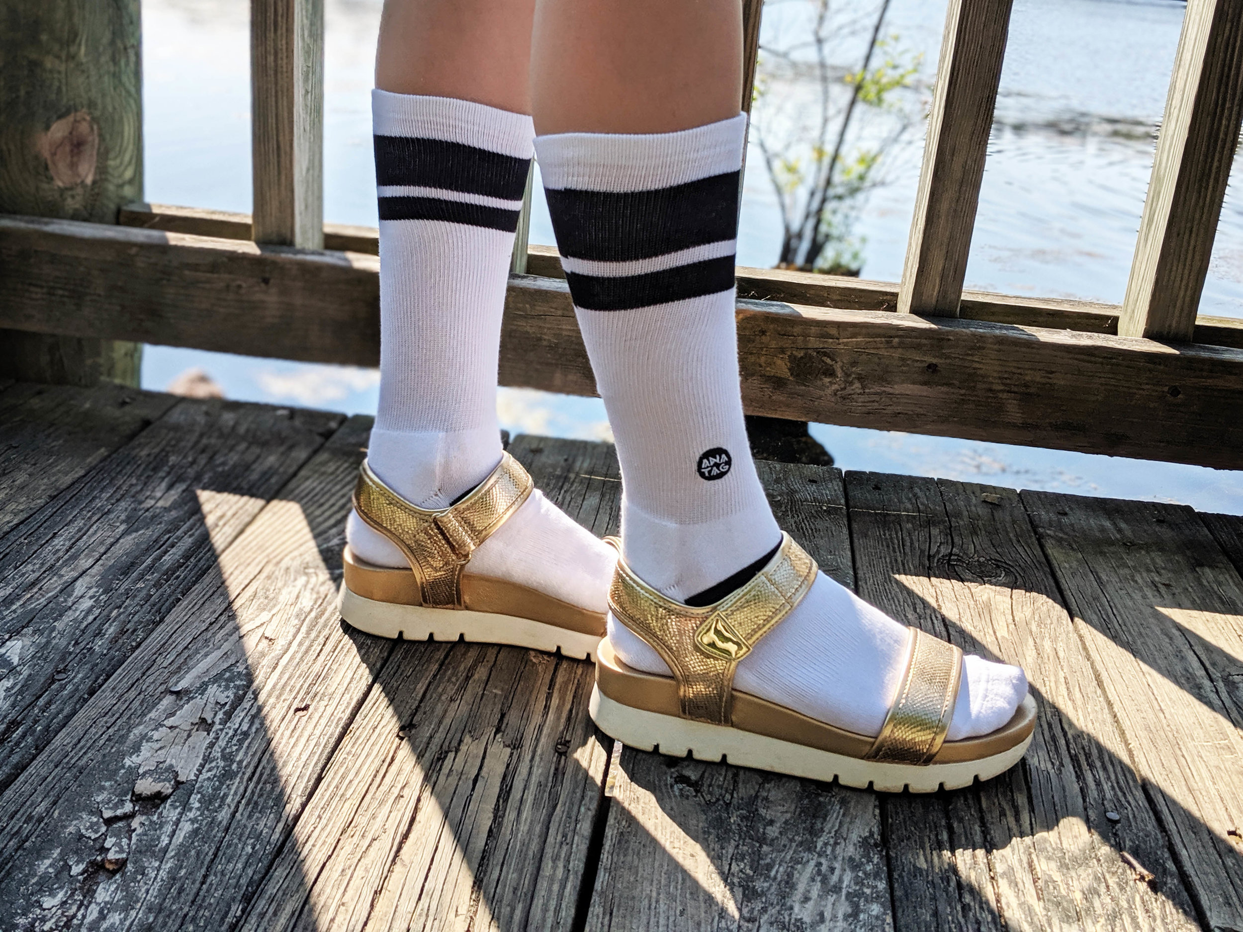 Anatag Socks - a pair by the pier, featuring 'Essential' in White.