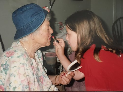 Parkinson's causes tremors of the hands. Nana couldn't apply her make-up, so I learned how to help her put on her lipstick. (And, in this picture, I was sharing one of my hats with her.)