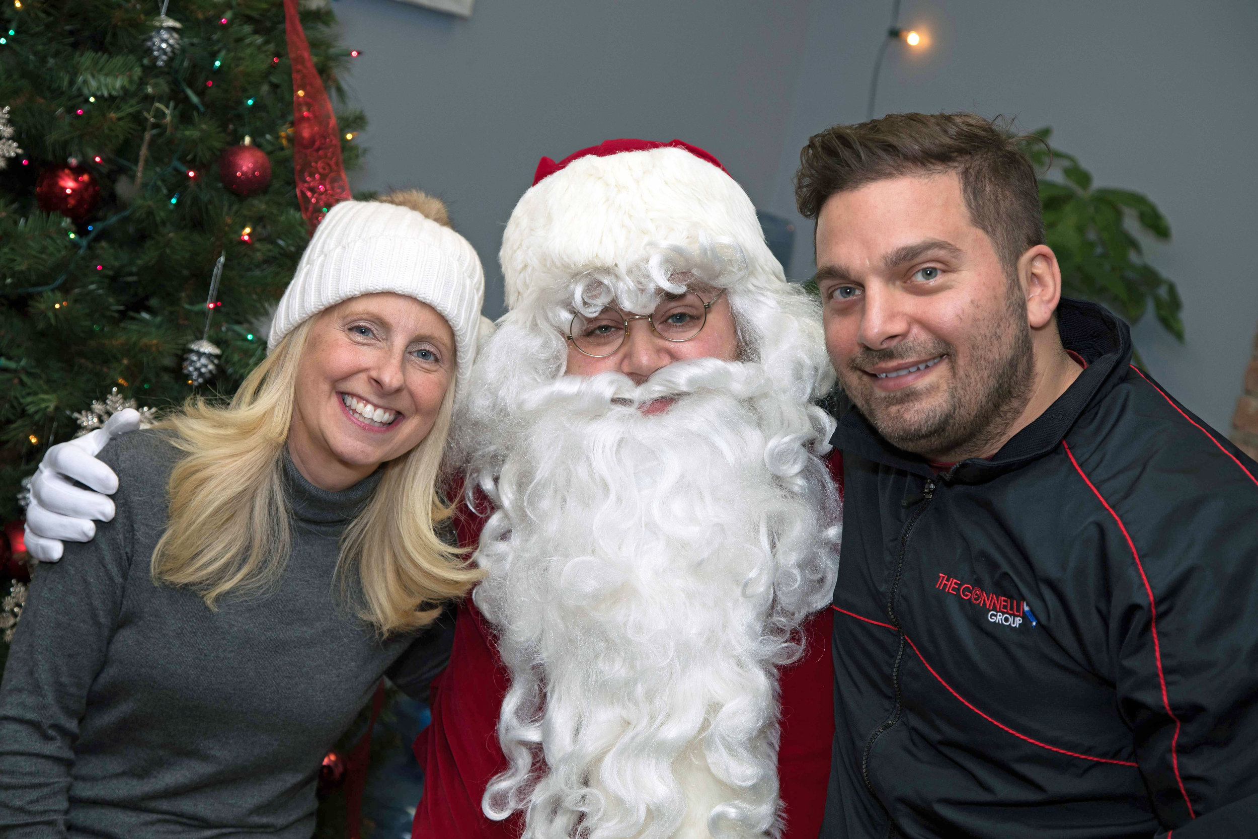 Hosts (from left to right) : Sonia Andriani, Santa Clause, & Michael Gonnelli - Leaders of the Re/Max Infinity Team running a wonderful event for a great cause.