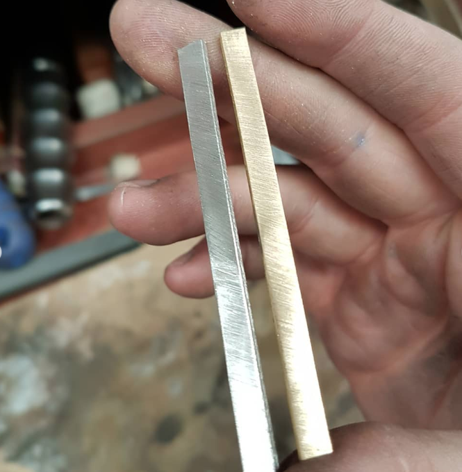 The two precious metal strips, ready to be turned up into rings.