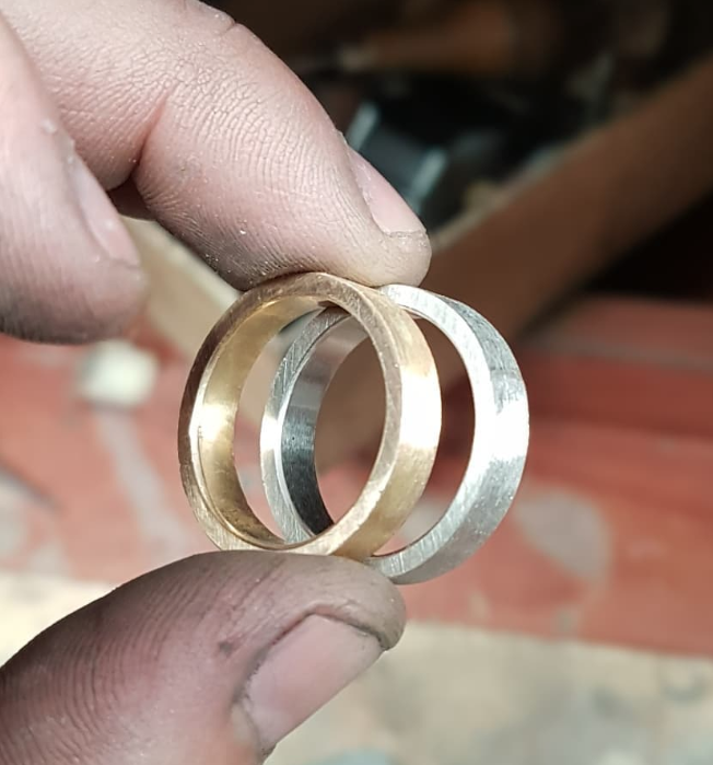 The individual bands are turned up, filed to exact widths and soldered together.