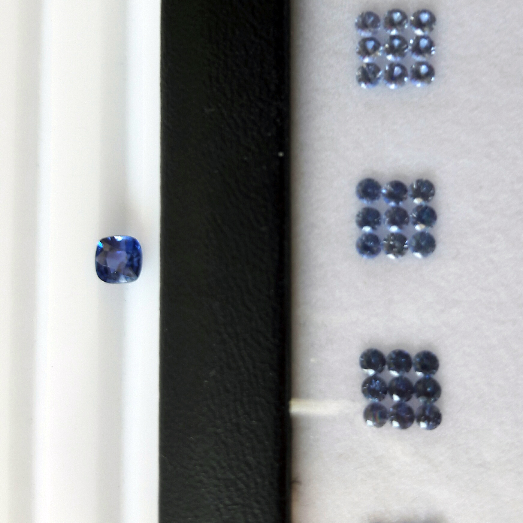 In search of the perfect cushion cut blue sapphire - After settling on the budget and an approximate idea, Emi has found the most beautiful untreated certified cushion cut blue sapphire in France that was perfect for the original idea.