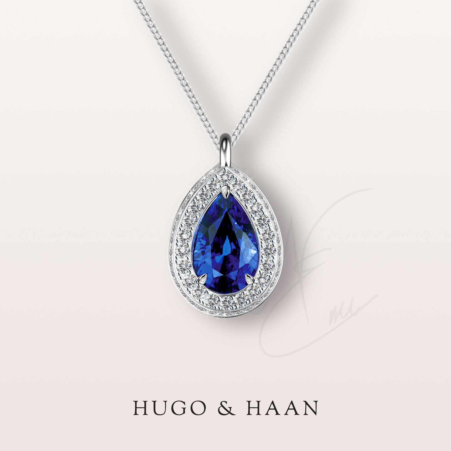 A gift to remember - One of our clients has approached us for a special birthday present. He knew he wanted a pendant and soon fell head over heels for a pear cut blue sapphire Emi showed him from a recent trip to France.
