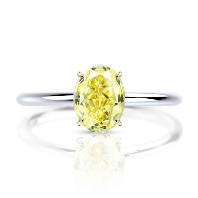 Sometimes less is more - this eye catching GIA 1.5ct Oval Fancy Intense Yellow Diamond doesn't call for anything fancy. Just an excellent setting with subtle claws to hold this piece of sunshine on your finger.⠀⠀⠀⠀⠀⠀⠀⠀⠀ ⠀⠀⠀⠀⠀⠀⠀⠀⠀ Please note that all of our pieces are custom designed and custom made in London. If you are interested in pricing or designs, please feel free to send us an email to design@hugoandhaan.com. We are happy to help.⠀⠀⠀⠀⠀⠀⠀⠀⠀ - ⠀⠀⠀⠀⠀⠀⠀⠀⠀ #yellowdiamonds #yellowdiamondring #yellowdiamondengagementring #bespoke #jewellerydesigner #lovediamonds #engagementrings #uniqueengagementrings #madeinlondon @hugoadhaan