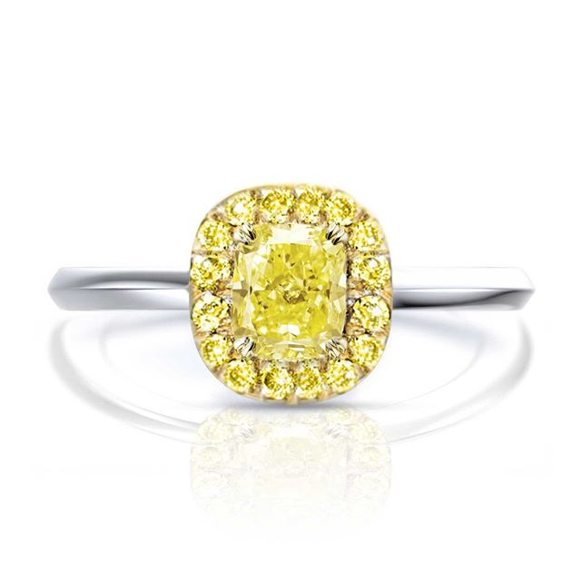 A soft halo - This stunner GIA 0.92ct Fancy Yellow Cushion Diamond found it's perfect nest in a halo of yellow gold and yellow diamonds. Little bit of a vintage feel and a whole lot of colour.⠀⠀⠀⠀⠀⠀⠀⠀⠀ -⠀⠀⠀⠀⠀⠀⠀⠀⠀ Please note that all of our pieces are custom designed and custom made in London. If you are interested in pricing or designs, please feel free to send us an email to design@hugoandhaan.com. We are happy to help.⠀⠀⠀⠀⠀⠀⠀⠀⠀ - ⠀⠀⠀⠀⠀⠀⠀⠀⠀ #yellowdiamonds #yellowdiamondring #yellowdiamondengagementring #bespoke #jewellerydesigner #lovediamonds #engagementrings #uniqueengagementrings #madeinlondon @hugoadhaan