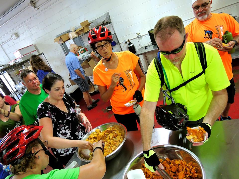 Cyclists sample some delicious OH! Chips during a stop on the ride. Photo credit: Bryan Barr