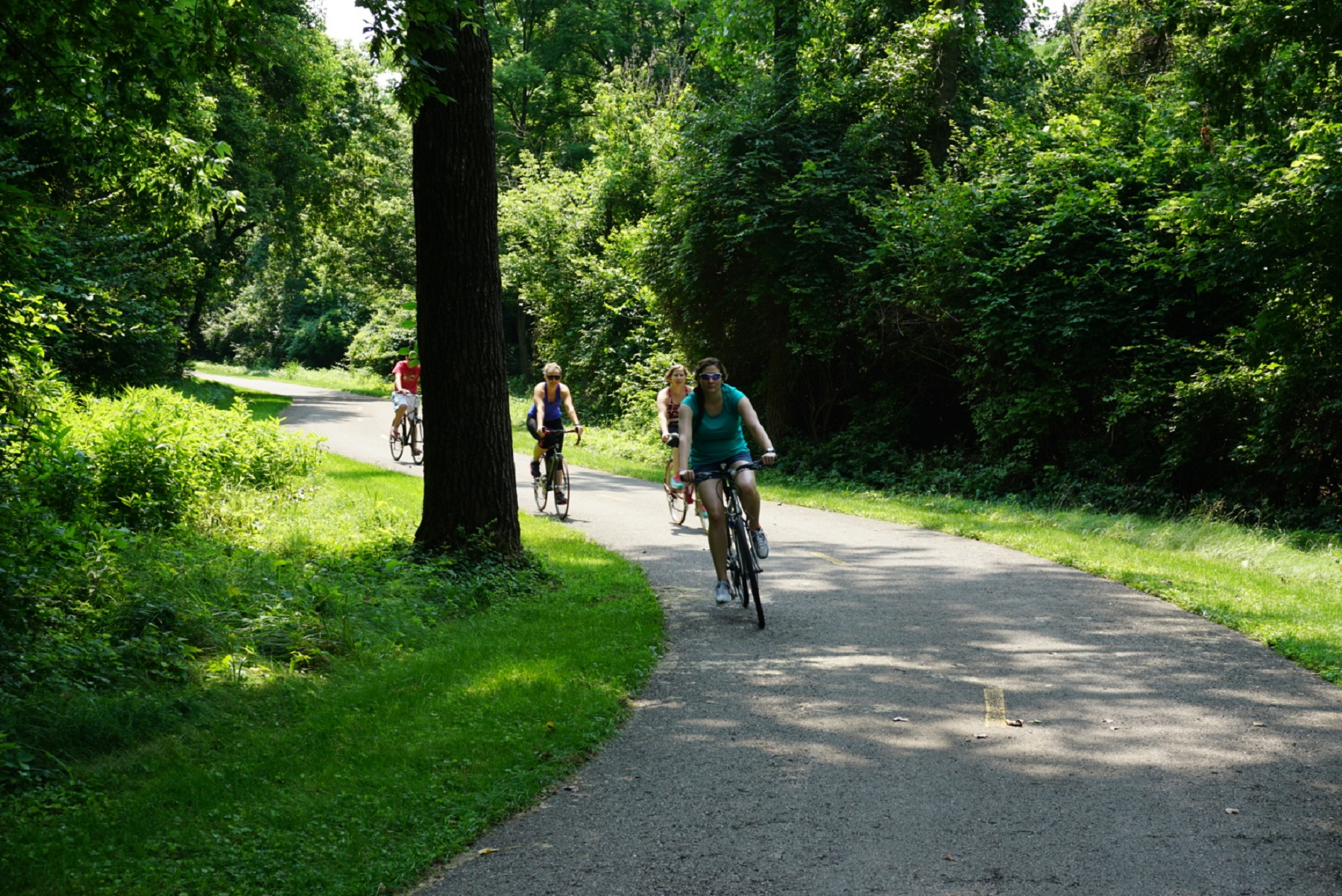 Cyclists ride a greenways trail.Photo source: planning-next.com