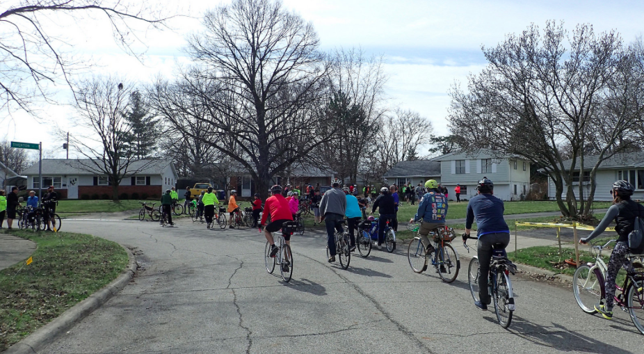 Riders arrive at a house on a quiet street in North Columbus. Photo credit: Ray George