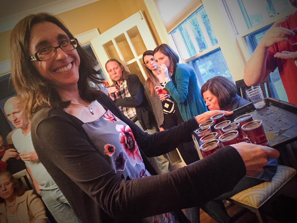 Board member Kathleen Koechlin serves up some delicious wine at a previous wine tasting fundraiser.