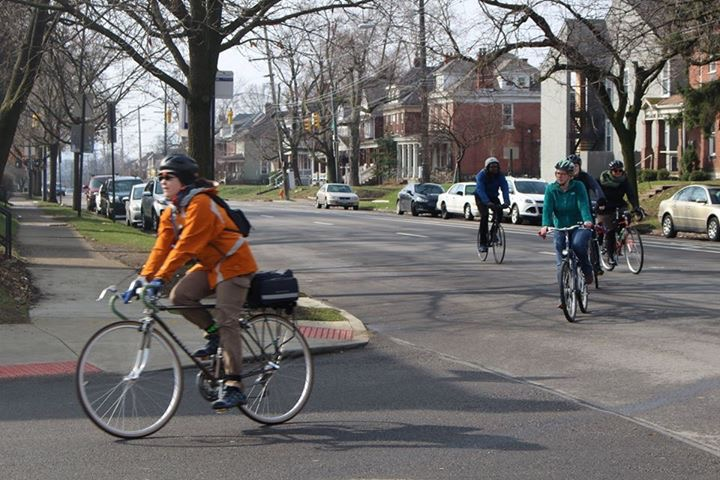 A trainee practices leading a How We Roll ride through the University District.