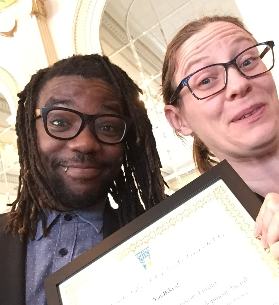 Deo & Meredith accepting an award from the Greater Ohio Policy Center, who nominated us for a Greater Ohio Sustainable Development Award in the Non-profit Luminary category.