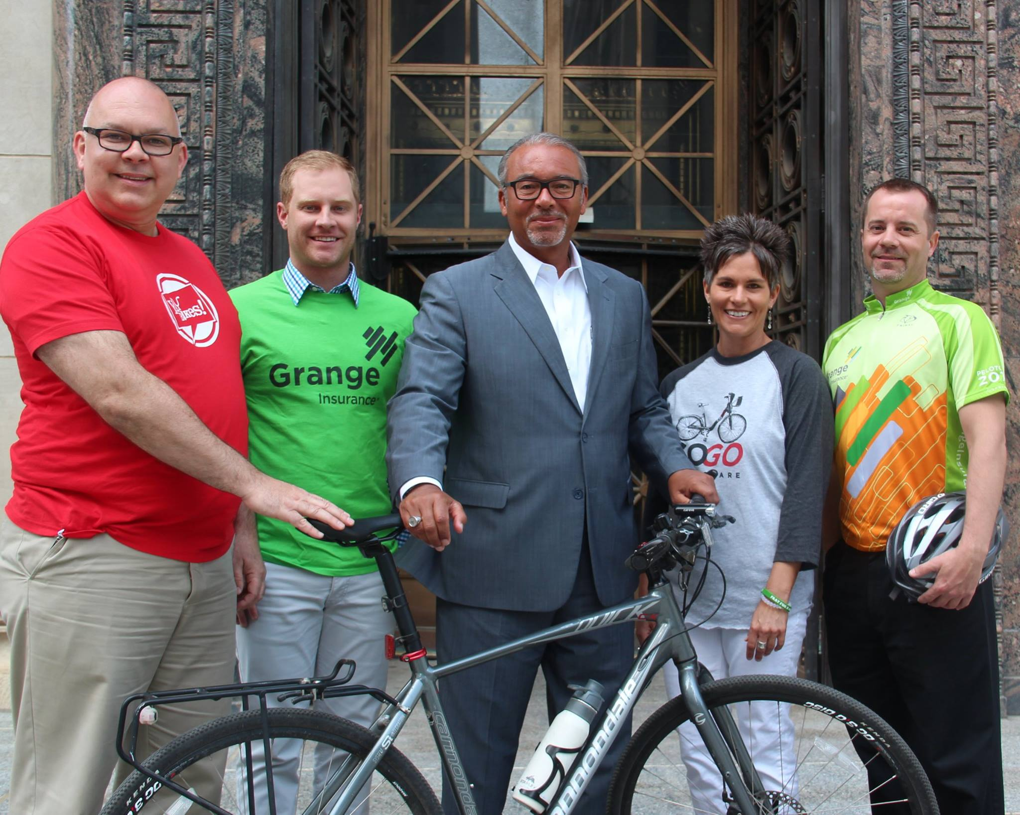"""With former Columbus Mayor Michael """"Bikin' Mike"""" Coleman, promoting bicycling alongside several Grange colleagues."""