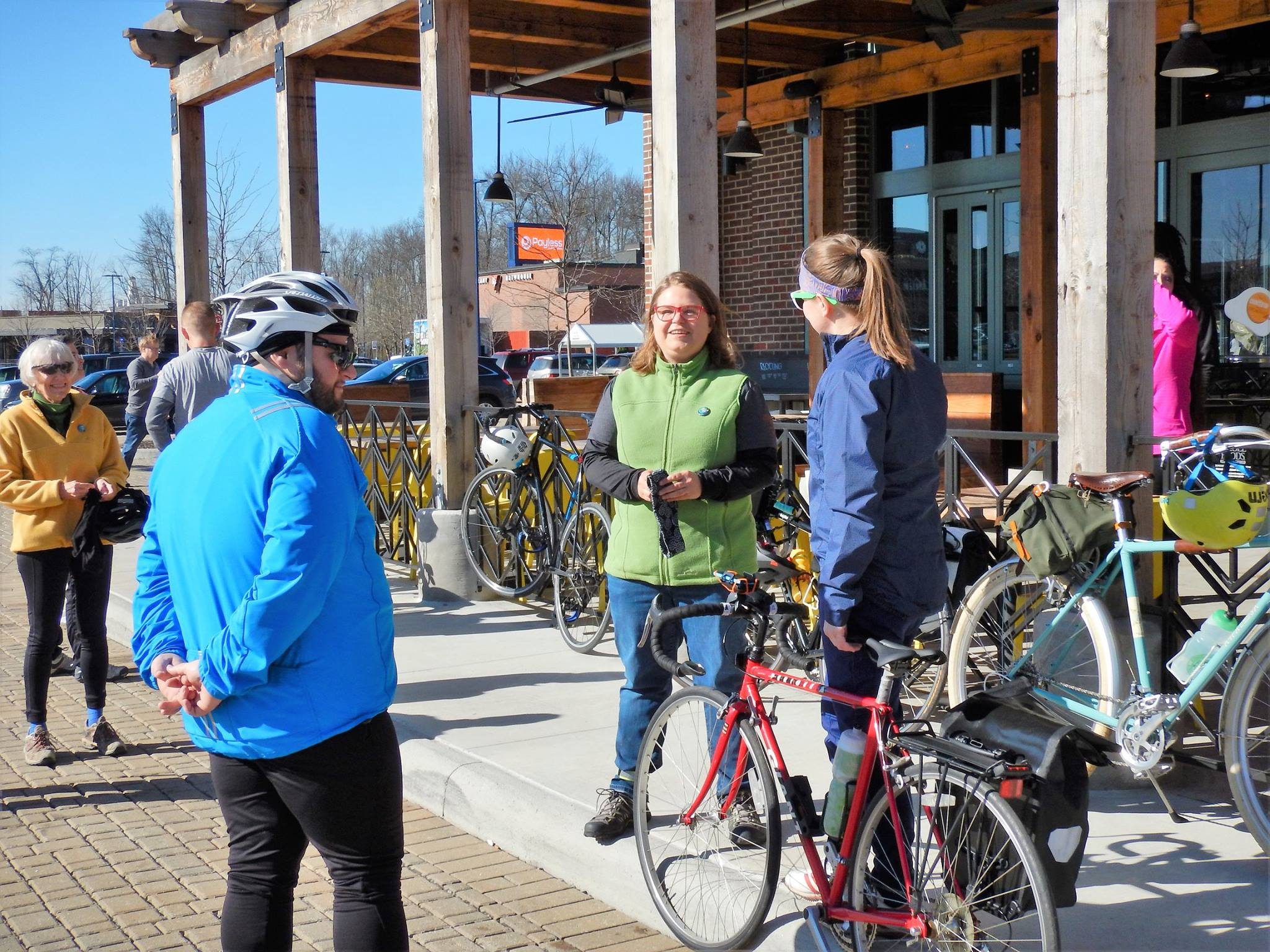 Ride leader Rahel Babb (in green) greets people as they arrive to Whole Foods Market. Photo credit: Keith 'Lugs' Mayton
