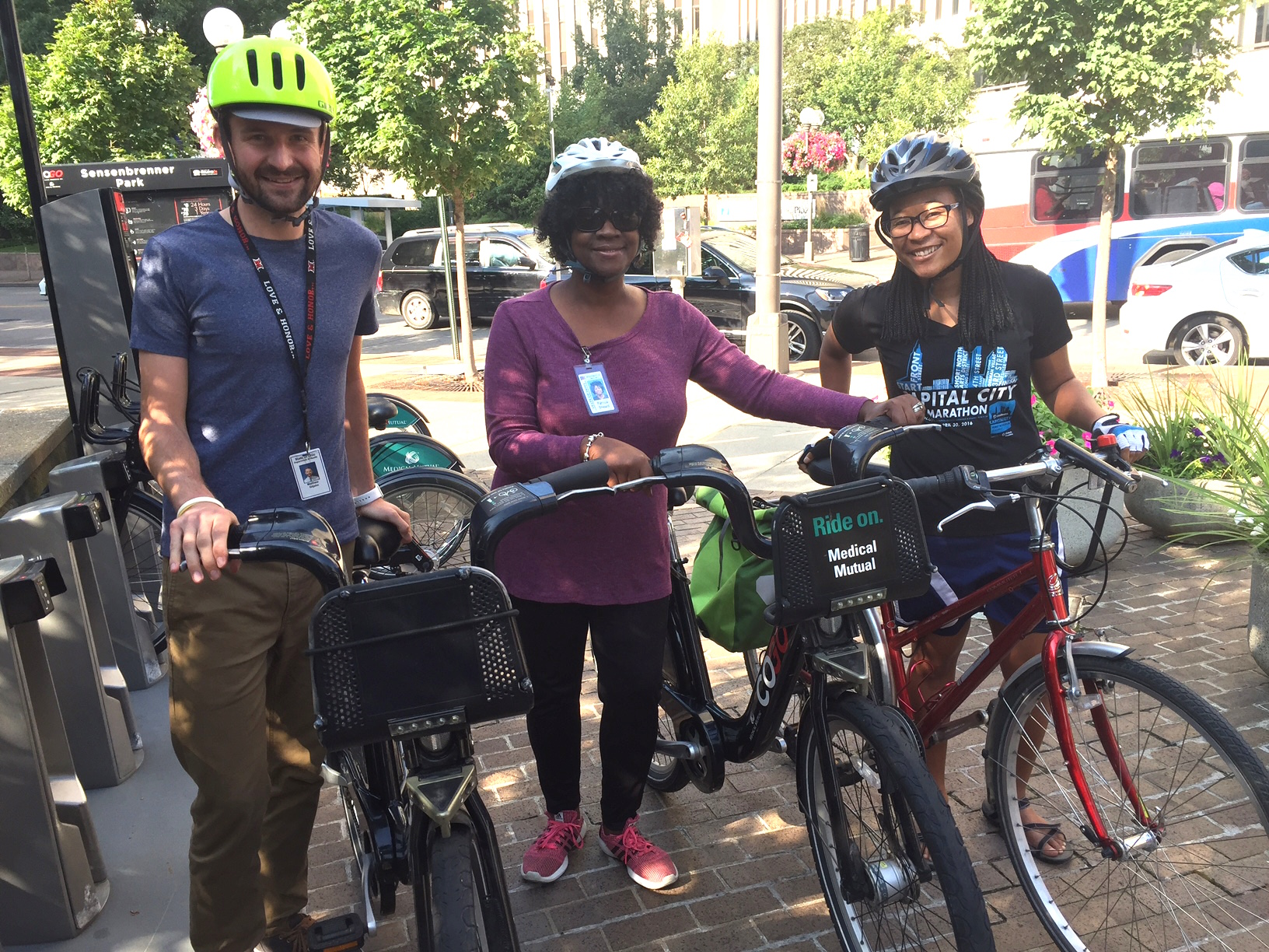 Tonni, right, joins her Ohio Department of Health colleagues on a Ride Buddy ride.