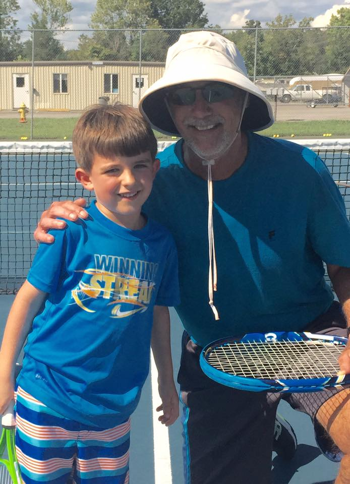 Coach Michael Bales and a very young, very feisty TTCA champion!