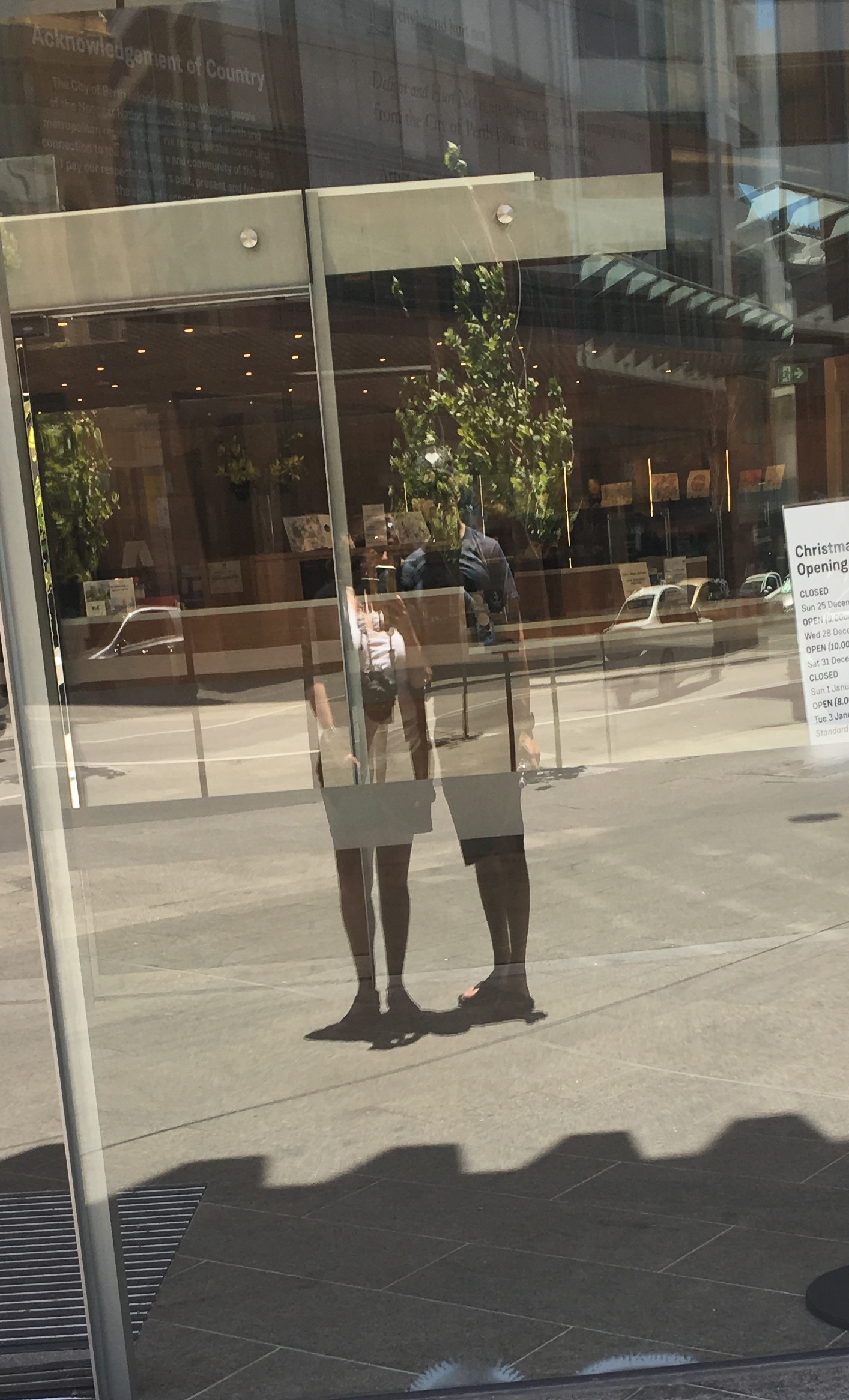 Our reflection in a shop window, Perth (we haven't got matching skirts on, honest!)
