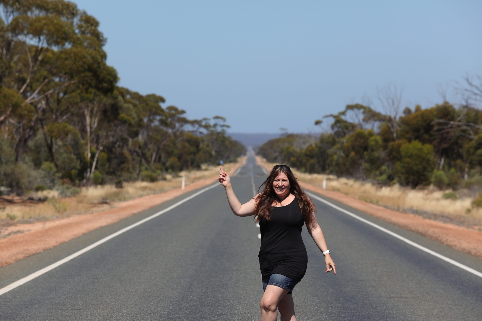 Dancing in the middle of the empty road!