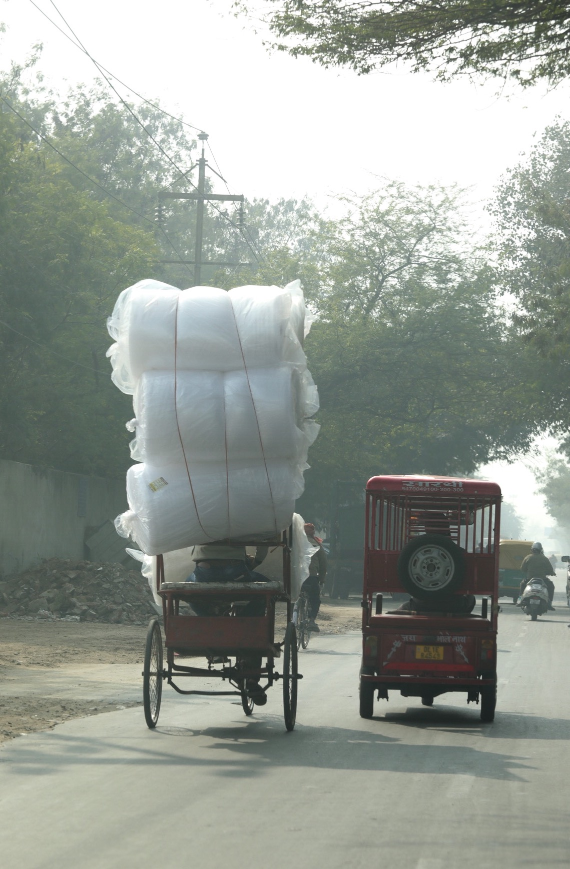 Luckily for the driver in the rickshaw on the left, this was bubble wrap!