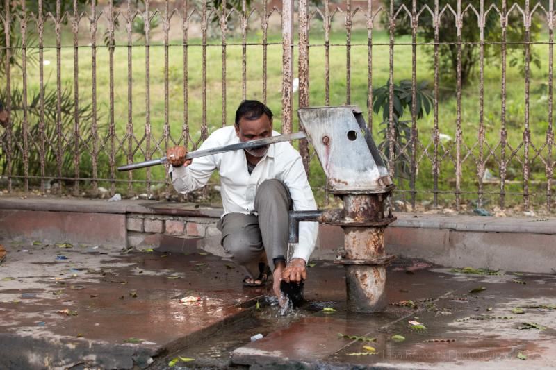 Pumping water, Agra, Uttar Pradesh, India