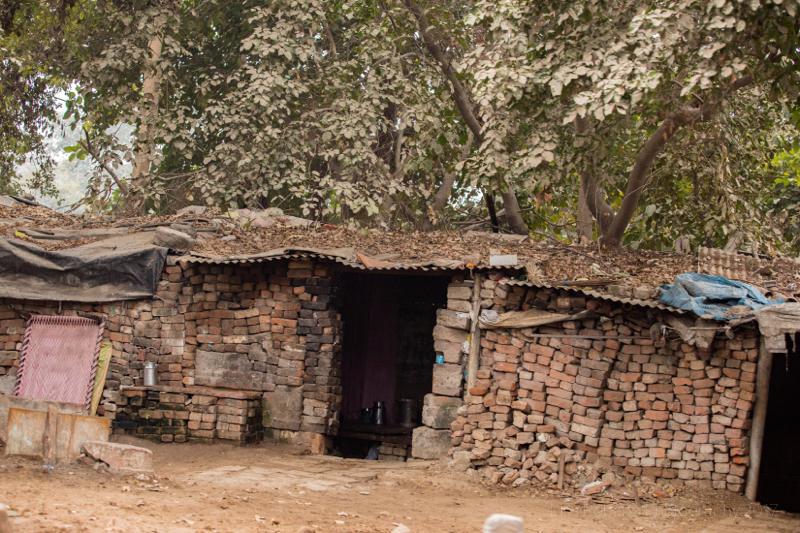 Brick hutStreet seller with cow,Agra, Uttar Pradesh, India