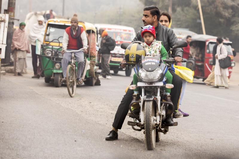 Three on a moped,Agra, Uttar Pradesh, India