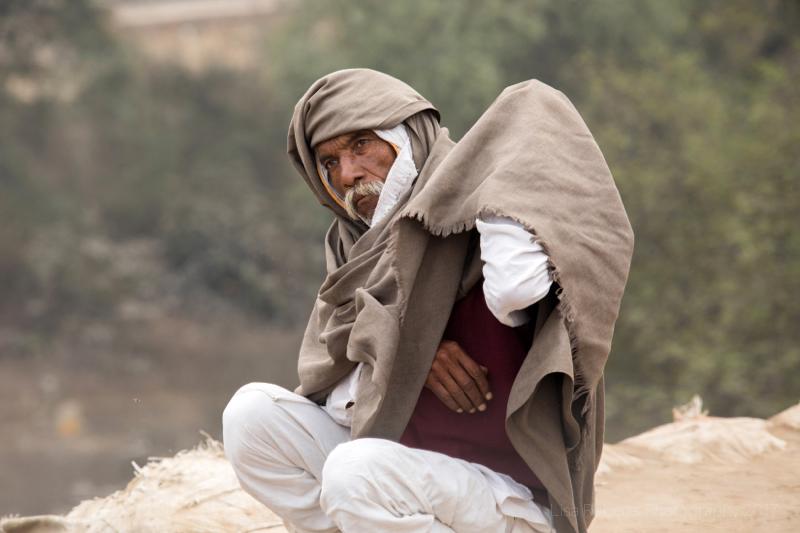 Man sitting, Mathura, Uttar Pradesh, India