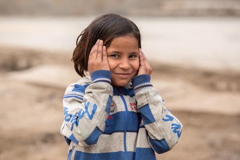 Girl with hands on her face, Mathura, Uttar Pradesh, India