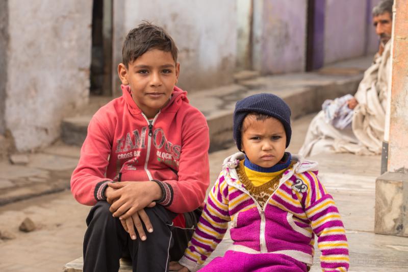 Boy & girl sitting,Child with spirit,Mathura, Uttar Pradesh, India