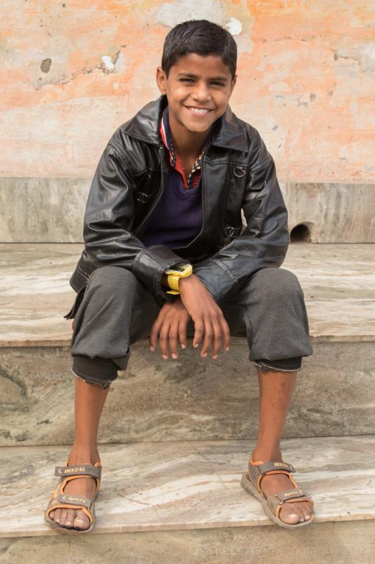 Smiling boy in leather jacket, Mathura, Uttar Pradesh, India
