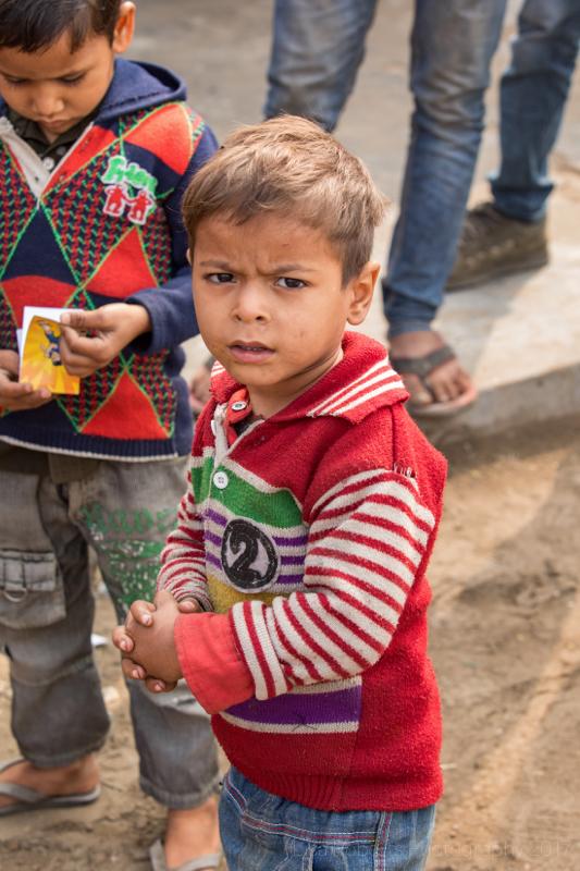 Boy in red & white striped sleeves, Mathura, Uttar Pradesh, India