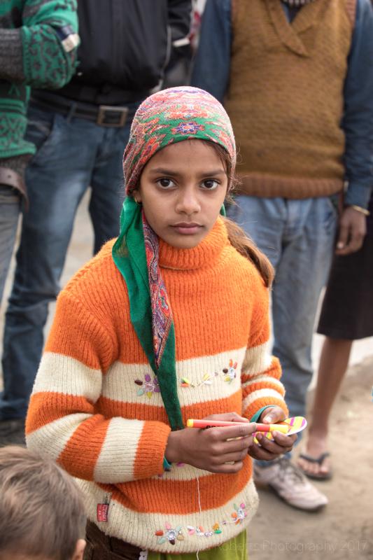 Girl in striped orange jumper, Mathura, Uttar Pradesh, India