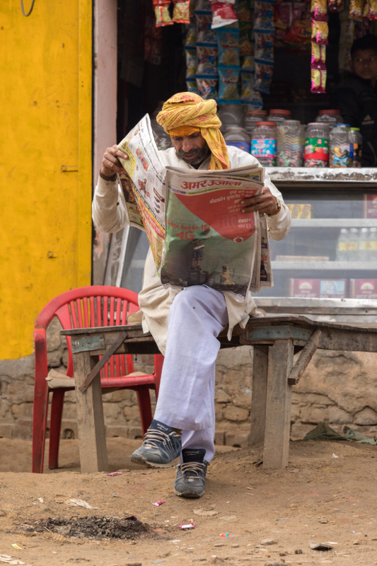 Catching up on the news, Kosi Kalan, India