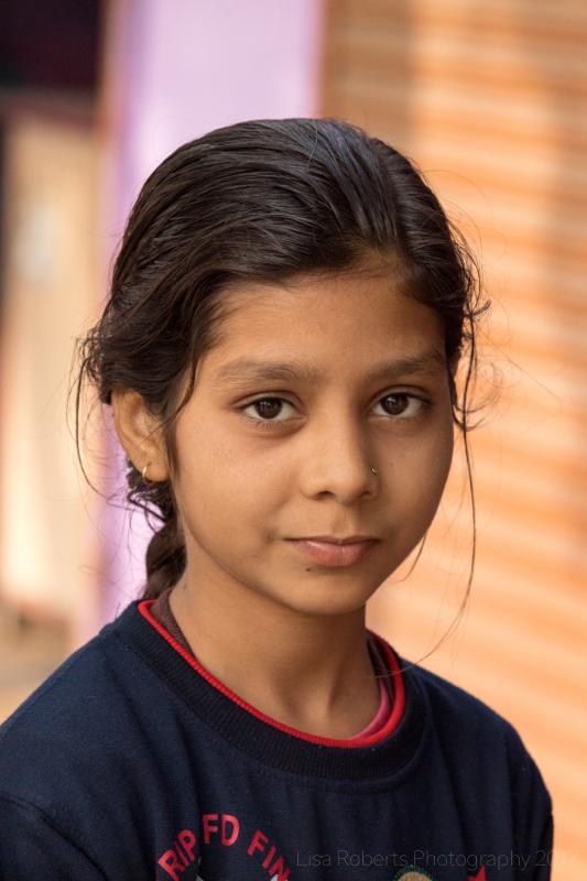 Girl in doorway, Palwal, India
