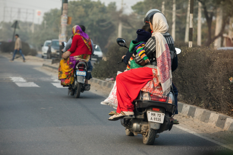 Women & babies on mopeds, Gurgaon Haryana, india