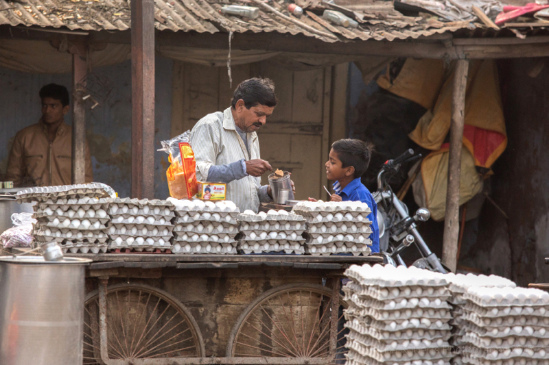 Boy chatting to egg seller, A tangle of wires, Gurgaon Haryana, India