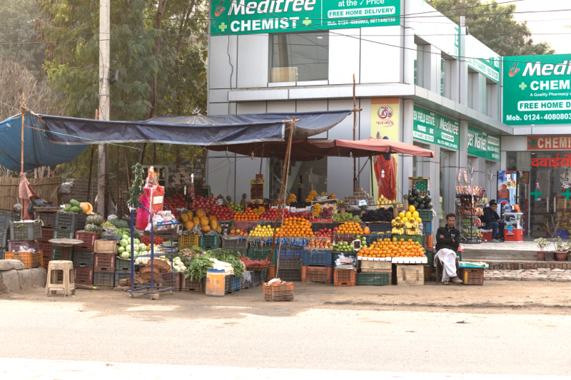 Fruit stall,Broken bicycle, Gargaon, Haryana, India