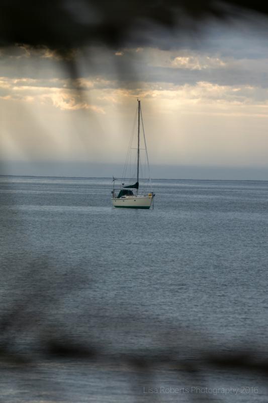 Yacht at sundown,Twofold Bay, Eden, NSW Australia
