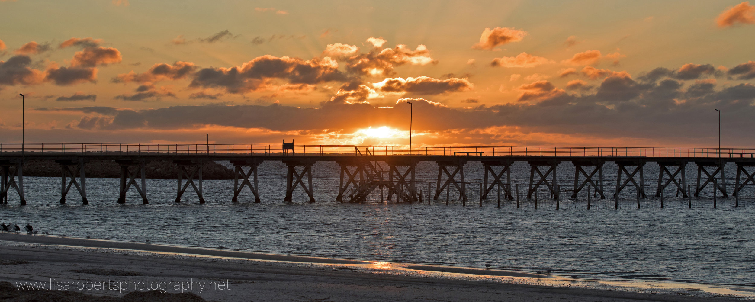 Sunset behind the pier, Smoky Bay, South Australia
