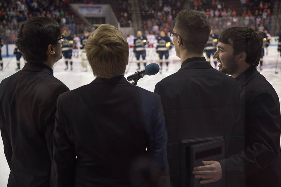 Singing the National Anthem at a Boston University Men's Hockey game. Contrary to popular belief, Seth is  not  a robot.