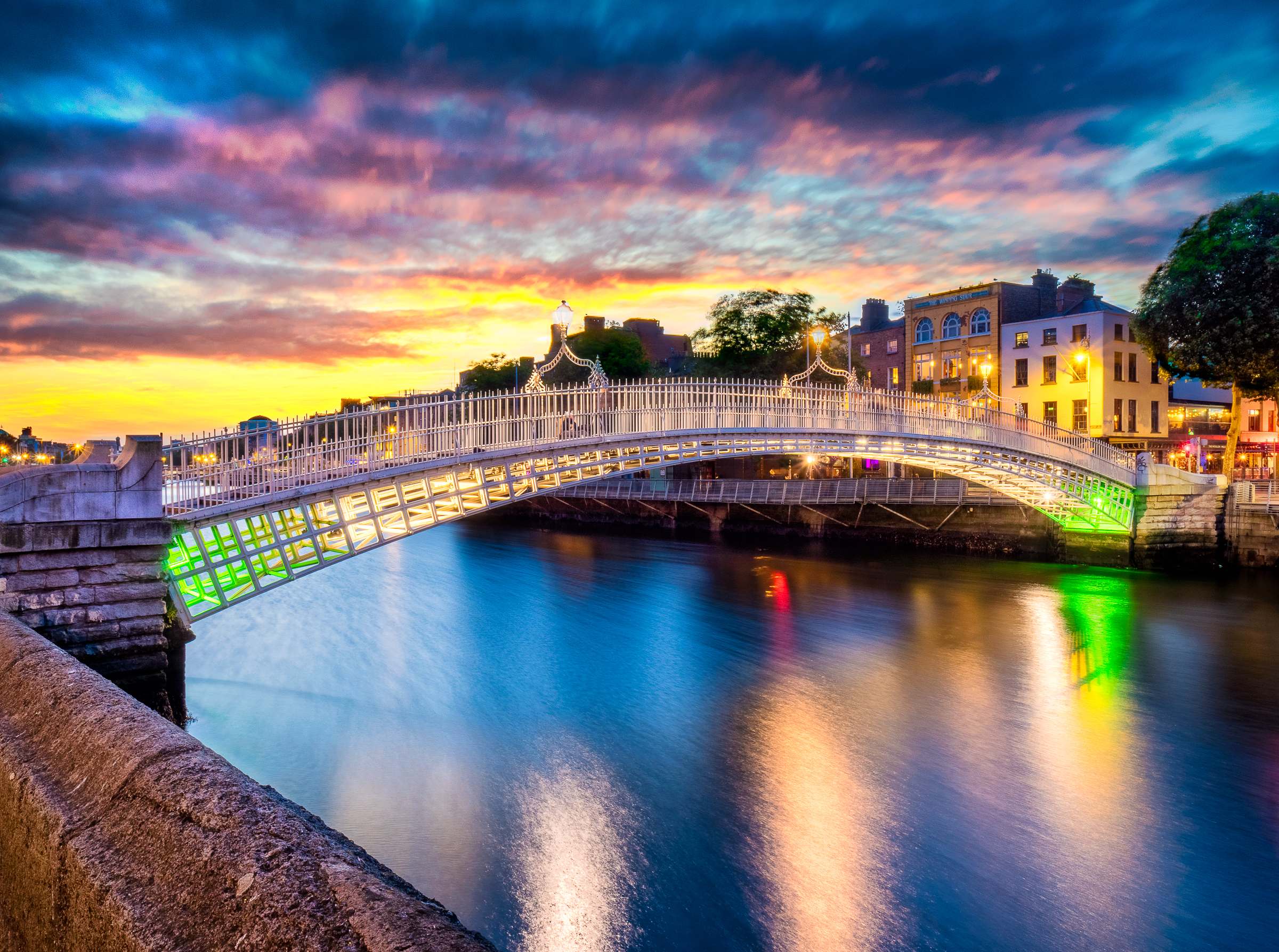 Ha'Penny Bridge at sunset in Dublin Ireland