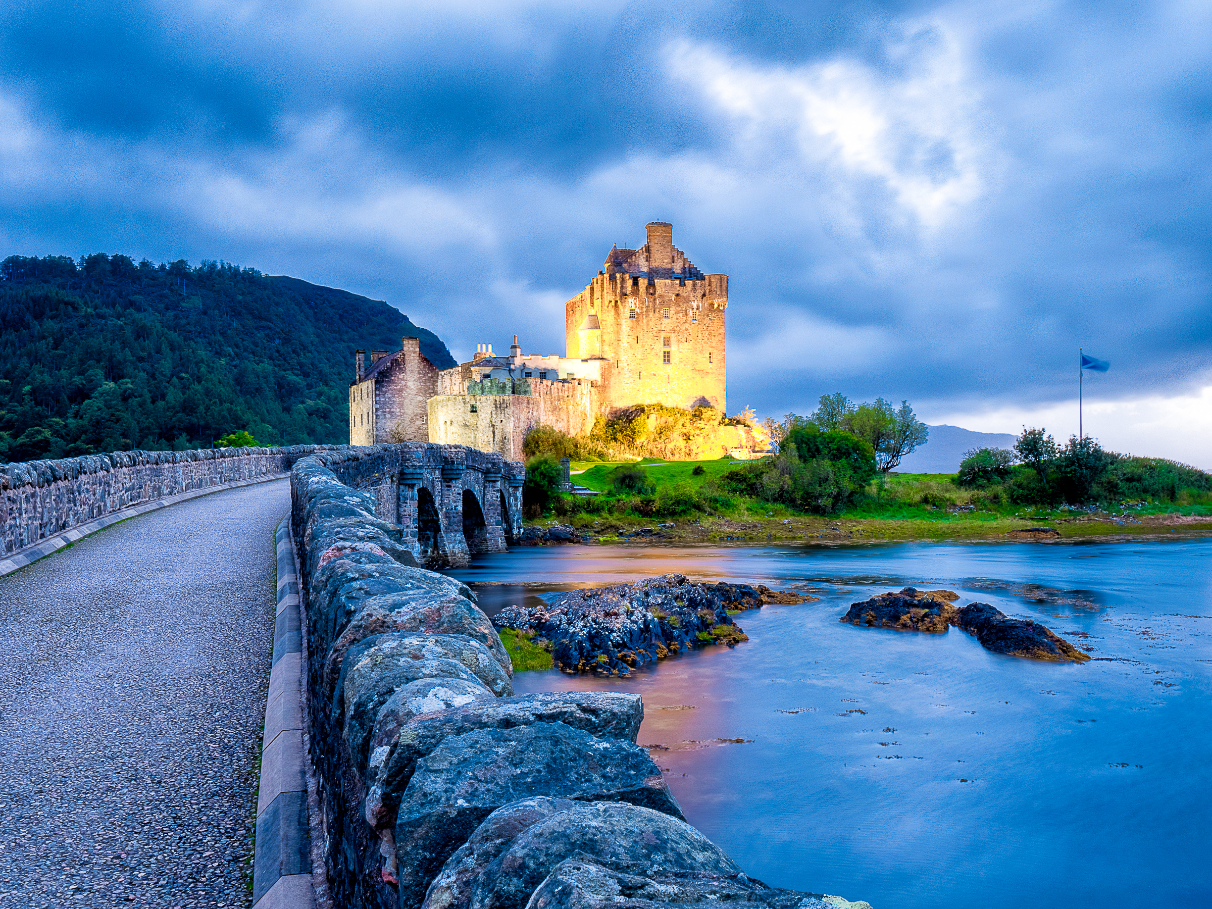 The famous Eilean Donan Castle at sunset in Scotland