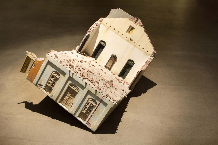 "A House on Joshi Lane | salvaged wood, concrete block, plaster, paint | 25"" x 21"" x 23"" 