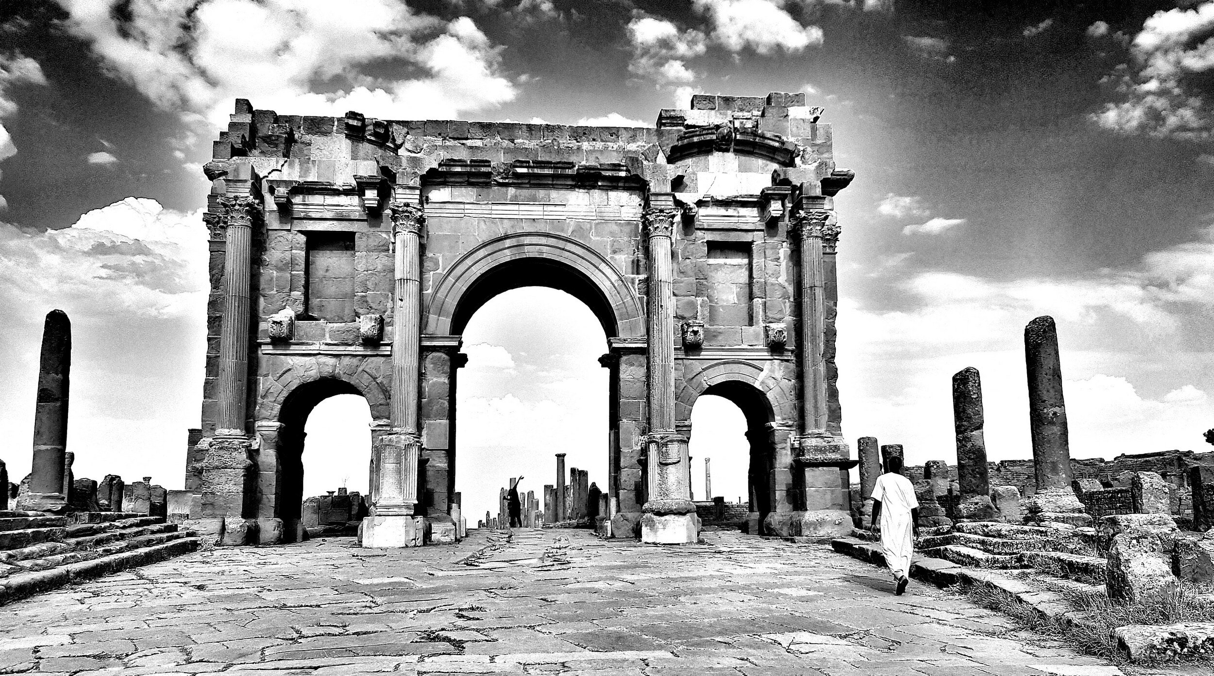 """The Cardo Maximus and the Arch of Trajan, Timgad 