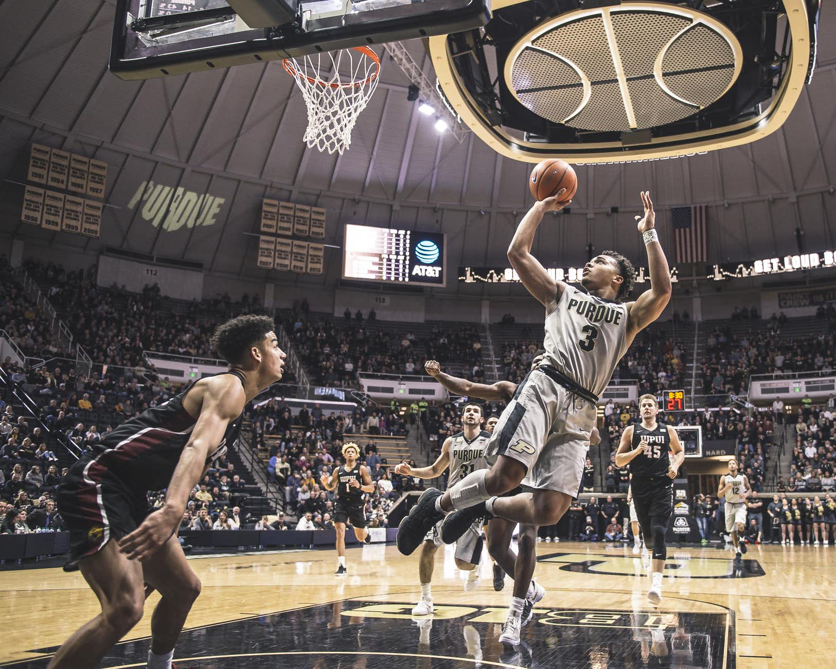 I don't know either, but this one went in too. Check the pbp if you don't believe it - 8:29, Carsen Edwards makes two point layup (Isaac Haas assists).