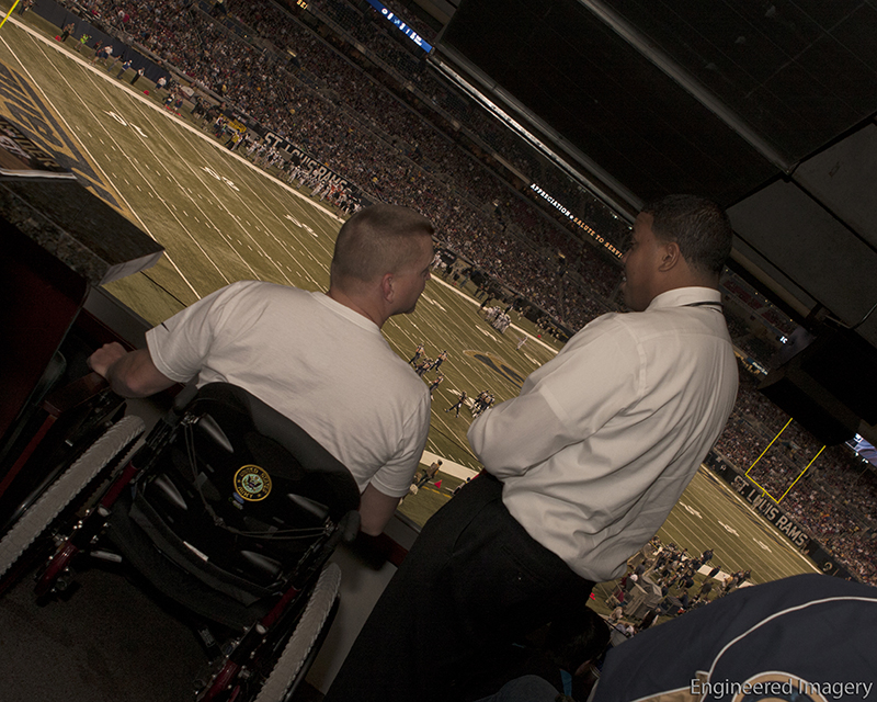 Warrior Summit Coalition President and Co-Founder James J. Flagg speaks with Soldier during a St. Louis Rams game.